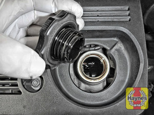 Illustration of step: Pour half the new oil in first, wait a minute for the oil to go to the sump, now start adding smaller amounts, keep checking dipstick level fill to the upper mark on the dipstick - step 5
