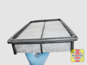 Illustration of step: Clean off any debris on the surface of the filter - step 8