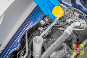 Illustration of step: Open the filler cap, note the built-in dipstick to determine fluid level - step 2