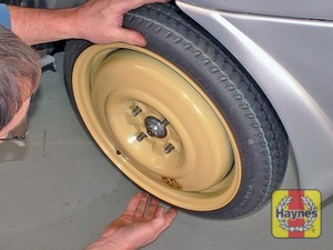 Illustration of step:  Fit the spare wheel, and screw on the nuts - step 9