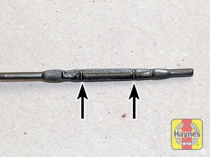 Illustration of step:  Note the oil level on the end of the dipstick, which should be between the upper maximum mark and lower minimum mark - Car care - step 12
