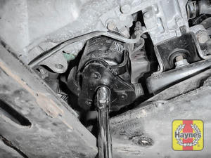 Illustration of step: Using the oil filter wrench, unscrew the filter anticlockwise and remove the old oil filter - step 3