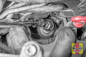 Illustration of step: Using a 27mm filter wrench socket, fit the tool securely onto the oil filter housing - step 3