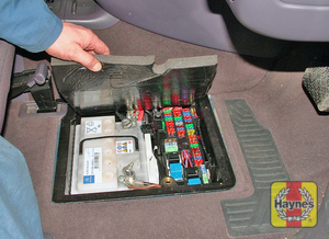 Illustration of step: Lift the driver's floor panel to access the main fusebox - step 1