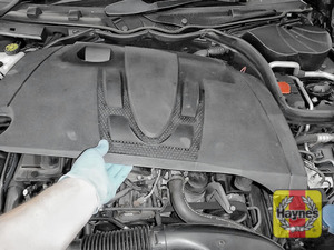 Illustration of step: You will need to remove the engine cover to access the steering fluid reservoir - step 1