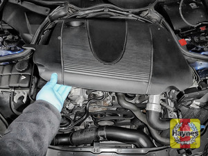 Illustration of step: You will need to remove the engine cover, it should just pop off the engine - use both hands - step 1