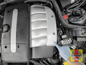 Illustration of step: The steering fluid reservoir is located under this engine cover - step 1