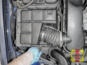 Illustration of step: Next, undo the six retaining clips on the air filter body - step 4