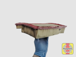 Illustration of step: Clean off any debris on the surface of the filter - step 9