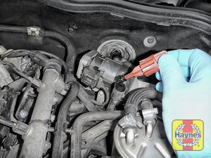 Illustration of step: Remove dipstick and place the vacuum extractor pipe down the dipstick tube - step 2