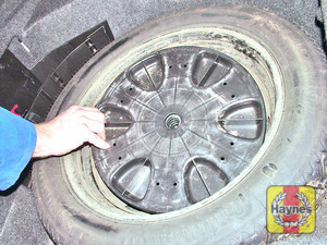 Illustration of step:  Rotate the cap anti-clockwise and lift out the spare wheel  - step 9