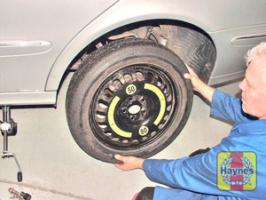 Illustration of step:  Fit the spare wheel and tighten the retaining bolts  - step 17
