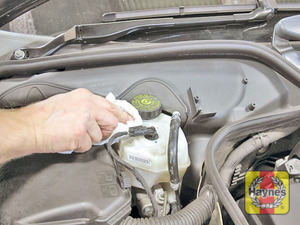 Illustration of step:  Wipe around the filler cap  - Safety first! - step 37