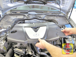 Illustration of step:  Pull the cover up from the rubber mountings - V6 engines  - Power steering fluid - step 50
