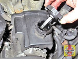 Illustration of step:  Power steering fluid reservoir cap  - Power steering fluid - step 52