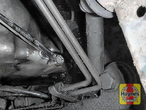 Illustration of step: Using a 13mm spanner or socket, carefully remove the sump plug and fully drain the oil - step 4