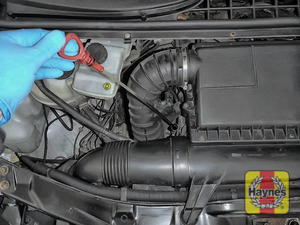 Illustration of step: Remove the dipstick and place the vacuum extractor pipe down the dipstick tube - step 1
