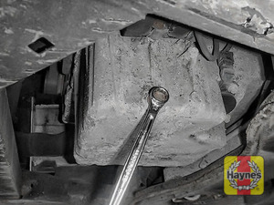 Illustration of step: Using a 13mm spanner or socket, carefully remove the sump plug and fully drain the oil - step 3