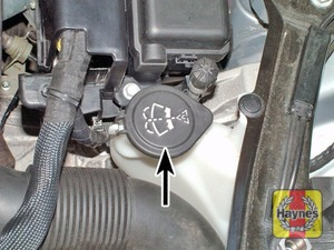 Illustration of step:  The screen washer fluid reservoir is located on the left-hand side of the engine compartment, and the headlight washers are supplied from the same reservoir - Screen washer fluid level - step 32