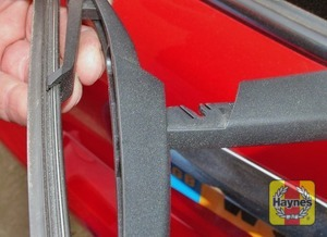 Illustration of step:  To remove a rear wiper blade, pull the arm away from the screen, turn the blade 90° to the arm, and press the blade pivot pin out the recess in the arm - step 3