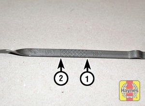 Illustration of step:  Note the oil level on the end of the dipstick, which should be between the upper maximum mark (1) and lower minimum mark (2) - Car care - step 8