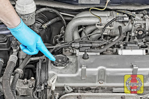 Illustration of step: Locate the oil filler cap and turn it anticlockwise to open - step 5