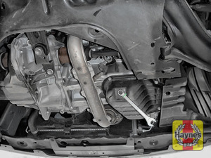 Illustration of step: Use a 14mm spanner or socket to carefully remove the sump plug and fully drain the oil - step 3