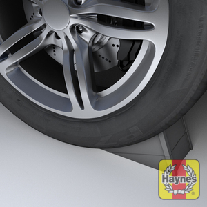 Illustration of step: Try and use a wheel chock on the wheel diagonally opposite the one being replaced - step 1