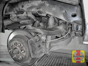 Illustration of step: Take a good look around the brake system and suspension arm, checking for any leaks - step 11