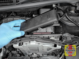 Illustration of step: Undo the two retaining clips and carefully lift the air filter cover - step 3