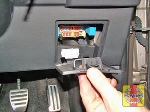 Illustration of step: The fusebox is located behind a panel on the driver's side of the fascia - step 1
