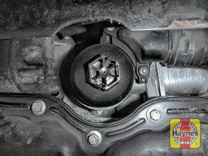 Illustration of step: Using a 27mm socket, fit the tool securely on to the oil filter housing - step 2