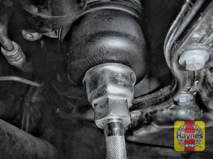 Illustration of step: Using a 27mm socket, fit the tool securely on to the oil filter housing - step 3