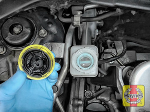 Illustration of step: If the level needs topping up – WEARING GLOVES – carefully open the cap, and have a paper towel ready to catch any drips as brake fluid is corrosive - step 3