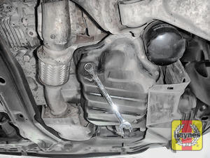 Illustration of step: Use a 14mm spanner or socket to carefully remove the sump plug and fully drain the oil - step 4