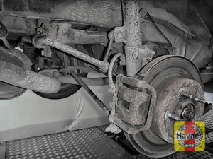 Illustration of step: Take a good look around the brake system and suspension arm, checking for any leaks - step 12
