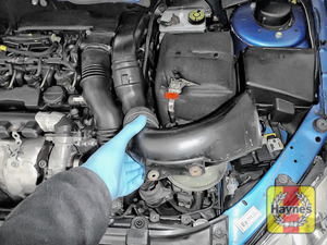 Illustration of step: WEARING GLOVES, remove the air intake using a 10mm socket - step 1