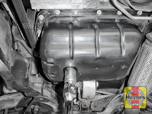 Illustration of step: With an oil catchment tray in position, use a 21mm spanner or socket to carefully remove the sump plug and fully drain the oil - step 5
