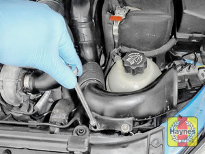 Illustration of step: To gain access to the oil filter cartridge, undo the two retaining bolts using a 10mm socket - step 1