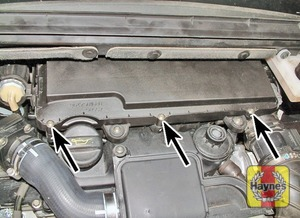 Illustration of step:  Undo the three air filter cover screws (arrowed), lift off the cover  - 1.4 litre engines - step 3