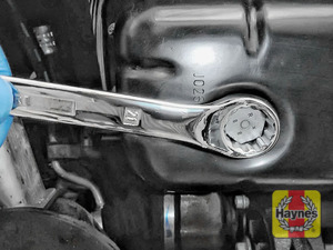 Illustration of step: Use a 21mm spanner or socket to carefully remove the sump plug and fully drain the oil - step 6
