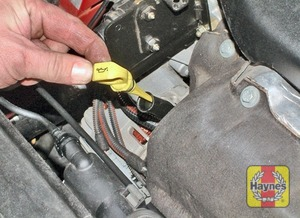 Illustration of step:  The dipstick is located at the front of the engine (see Underbonnet check points); The dipstick is often brightly coloured or has a picture of an oil can on the top for identification - Car Care - step 6