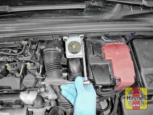 Illustration of step: Undo two retaining bolts on the brake fluid reservoir - use a Torx-20 socket  - step 3