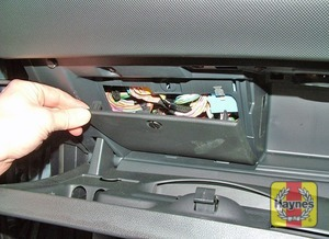 Illustration of step: Open the glovebox and unclip the panel to access the fusebox - step 1