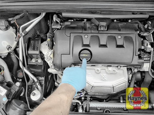 Illustration of step: Locate the oil filler cap and turn it anticlockwise to open - step 4