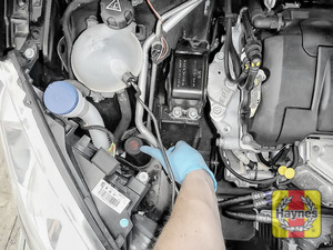 Illustration of step: The power steering fluid reservoir is located here, Always wear gloves - step 1