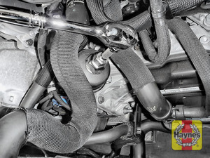 Illustration of step: Using a 27mm socket, fit the tool securely onto the oil filter housing - step 6