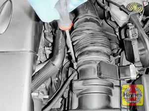 Illustration of step: Undo the circular clip on the air intake - use a 7mm socket or a Phillips screwdriver - step 3