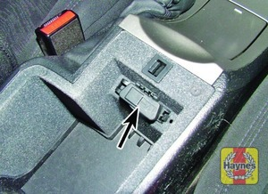 Illustration of step: Unclip the cover from the centre console to access the diagnostic socket - step 2