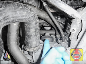 Illustration of step: The oil filter is accessed from underneath the vehicle - step 1